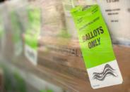 FILE PHOTO: Mail-in Ballots shipped from Orange County Registrar of Voters to U.S. Post Office for delivery