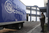 A soldier stands by a Health Ministry truck loaded with COVID-19 vaccines that El Salvador's government is donating and delivering to neighboring Honduras, before it departs San Salvador, El Salvador, Thursday, May 13, 2021. (AP Photo/Salvador Melendez)
