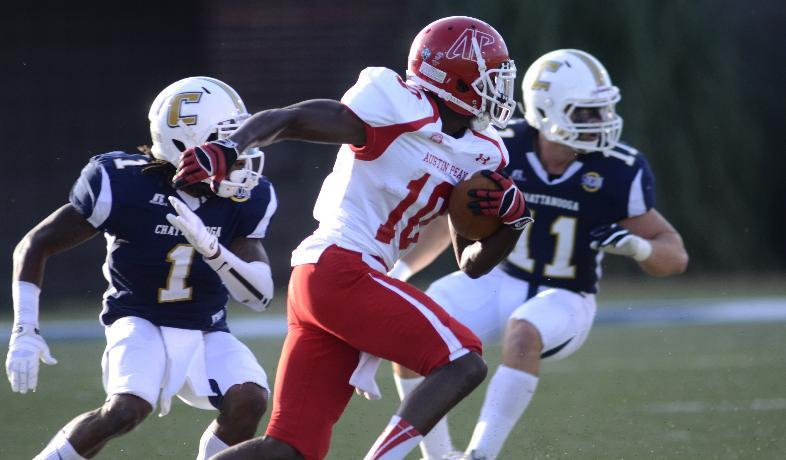 Austin Peay's LaDarius Chatman carries past Tennessee at Chattanooga's Chaz Moore (1) and Gunner Miller (11) during their NCAA college football game, Saturday, Sept. 14, 2013, at Finley Stadium in Chattanooga, Tenn