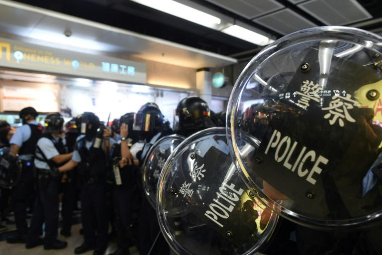 Protesters in Hong Kong are demanding an inquiry into the conduct of the police (AFP Photo/Philip FONG)
