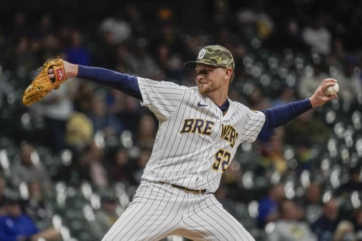 Milwaukee Brewers' Eric Lauer throws during the fourth inning of a baseball game against the Atlanta Braves Friday, May 14, 2021, in Milwaukee. (AP Photo/Morry Gash)