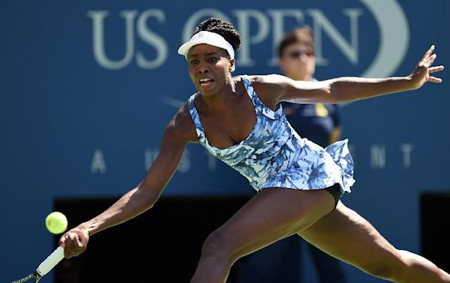 Venus Williams of the US returns to Kimiko Date-Krumm of Japan during their US Open 2014 women's singles match at the USTA Billie Jean King National Center August 25, 2014 in New York (AFP Photo/Don Emmert )