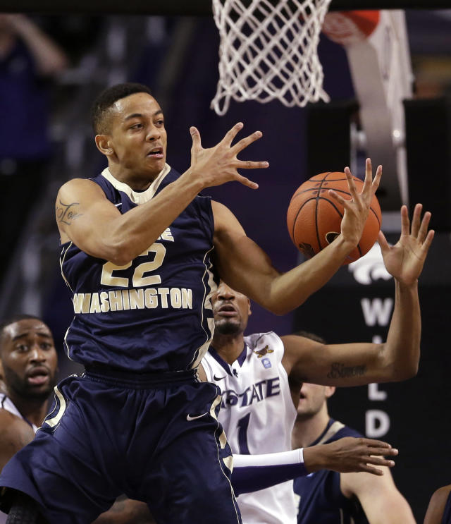 George Washington's Joe McDonald (22) and Kansas State's Shane Southwell (1) battle for a rebound during the first half of an NCAA college basketball game Tuesday, Dec. 31, 2013, in Manhattan, Kan. (AP Photo/Charlie Riedel)
