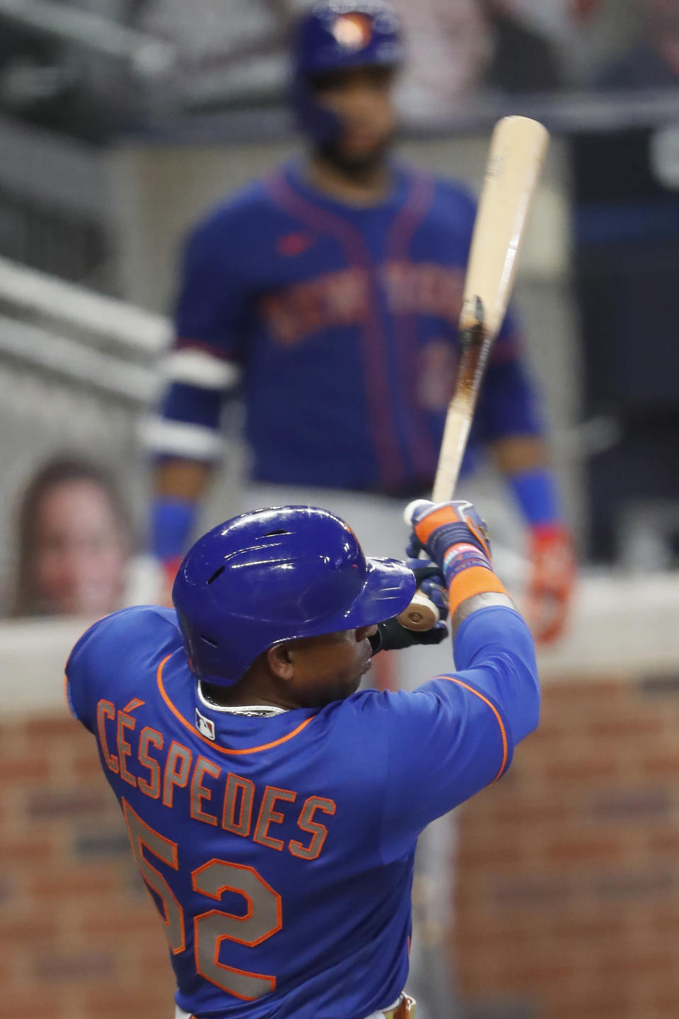 New York Mets' Yoenis Cespedes follows thorough on a two-run double in the fifth inning of a baseball game against the Atlanta Braves Friday, July 31, 2020, in Atlanta. (AP Photo/John Bazemore)