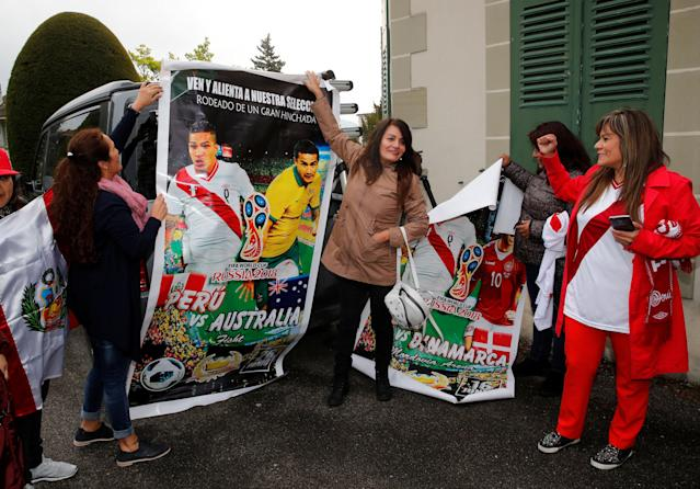 Supporters of Peruvian soccer player Paolo Guerrero stands outside the Court of Arbitration for Sports (CAS) before an appeal hearing in Lausanne, Switzerland, May 3, 2018. REUTERS/Denis Balibouse
