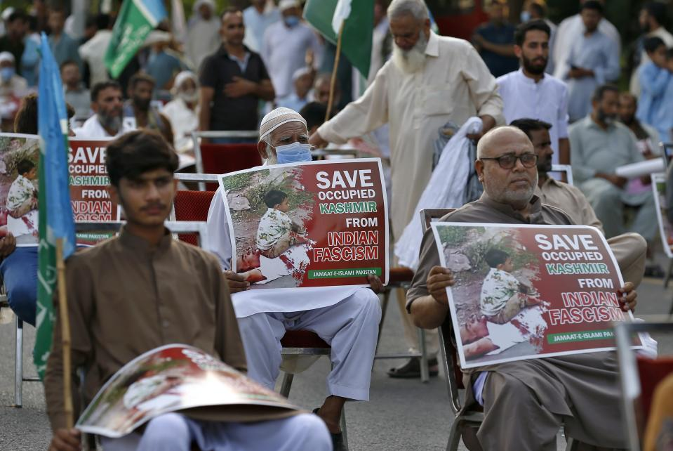 Supporters of a religious group Jamaat-e-Islami take part in a rally to show solidarity with Kashmiri people on the eve of first anniversary of India's decision to revoke the disputed region's semi-autonomy, in Islamabad, Pakistan, Wednesday, Aug. 5, 2020. Last year on Aug. 5, India's Hindu-nationalist-led government of Prime Minister Narendra Modi stripped Jammu and Kashmir's statehood, scrapped its separate constitution and removed inherited protections on land and jobs. (AP Photo/Anjum Naveed)