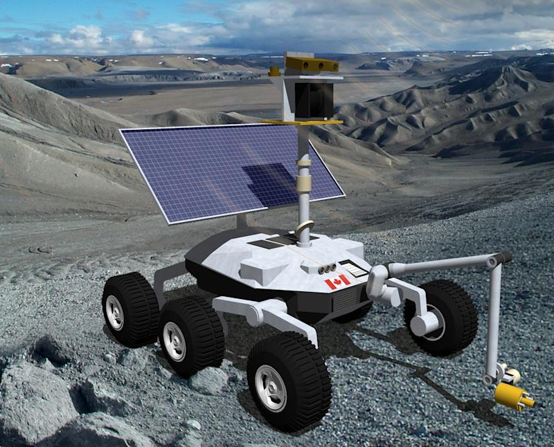 Six-wheeled rover with solar panel and probes on a rocky surface under a blue sky with white clouds.