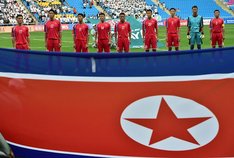 North Korean players sing the national anthem before the start of the match against China at the Asian Games in Incheon on September 15, 2014 (AFP Photo/Jung Yeon-Je)