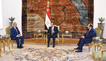 Libyan military commander Khalifa Haftar meets with Egyptian President Abdel Fattah al-Sisi at the Presidential Palace in Cairo