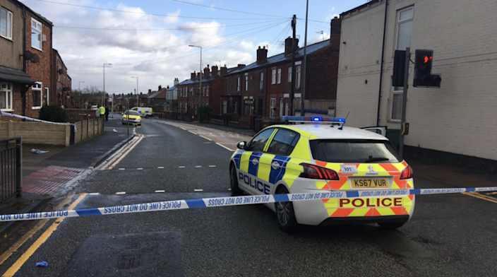 Police closed down Atherton Road, in Greater Manchester, after two women were stabbed (Picture: Yunus Mulla/BBC North West Tonight)