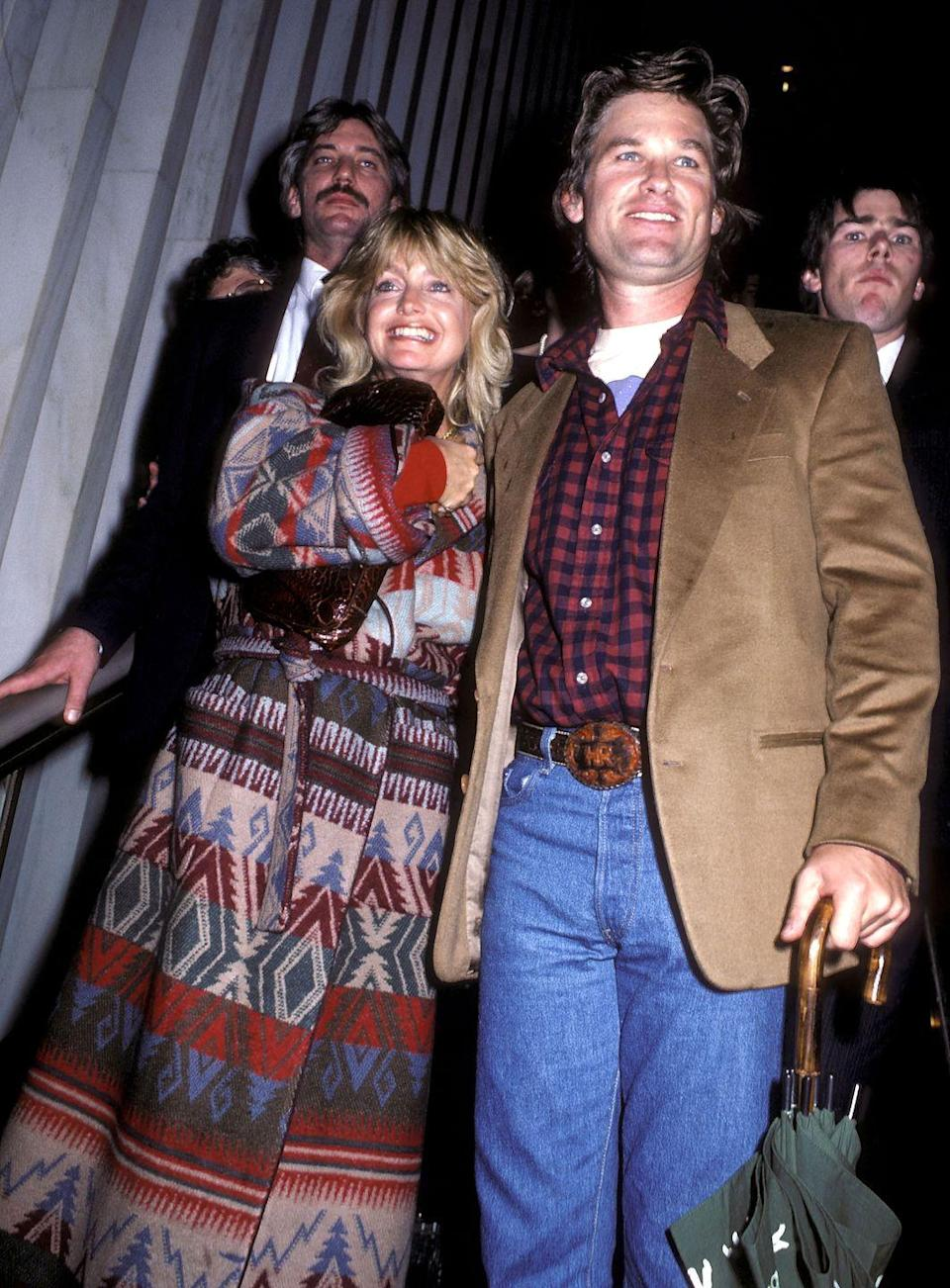 <p>Goldie Hawn and Kurt Russell brought folksy fall vibes to the grand opening of a new FAO Schwarz location. The plaid, denim, tribal-printed long coat, and beige suit jacket could all totally be found in a hipster, vintage shop this autumn.</p>
