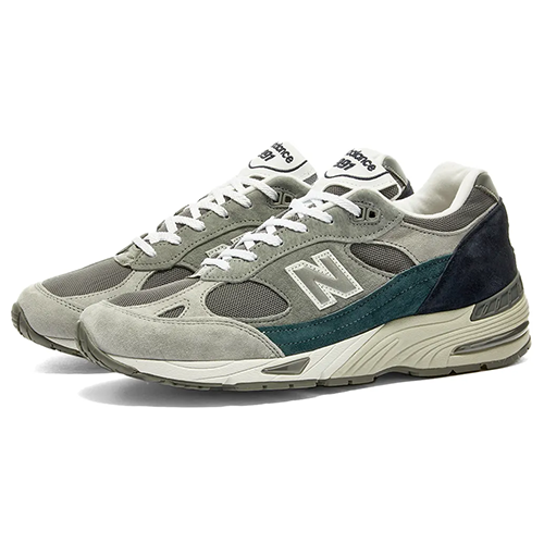"<p><a class=""link rapid-noclick-resp"" href=""https://www.endclothing.com/gb/new-balance-m991gbt-made-in-england-nu-block-m991gbt.html"" rel=""nofollow noopener"" target=""_blank"" data-ylk=""slk:SHOP"">SHOP</a></p><p>Crafted in New Balance's factory in Flimby, Cumbria, the subdued grey, green and navy colourway of the M991GBT help to balance out the shoe's wavily elaborate design. Proof, if you needed it, that you don't need to enlist zany, headache-inducing colours to draw attention to yourself (though they do a lot of that as well, FYI).</p><p>M991GBT – Made in England 'Nu Block', £169, <a href=""https://www.endclothing.com/gb/new-balance-m991gbt-made-in-england-nu-block-m991gbt.html"" rel=""nofollow noopener"" target=""_blank"" data-ylk=""slk:endclothing.com"" class=""link rapid-noclick-resp"">endclothing.com</a></p>"