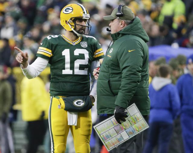 Green Bay quarterback Aaron Rodgers, left, defended his relationship with former coach Mike McCarthy. (AP)