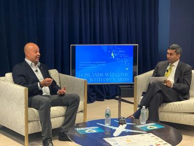"""Travel Leaders Group CEO Ninan Chacko, chats about ways to encourage travel to the Bahamas with Ellison """"Tommy"""" Thompson, Director General of The Bahamas Ministry of Tourism."""