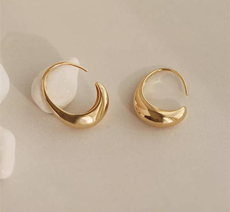 <p>These <span>Gold Dangle Earrings</span> ($34) will add a touch of elegance to any casual outfit.</p>