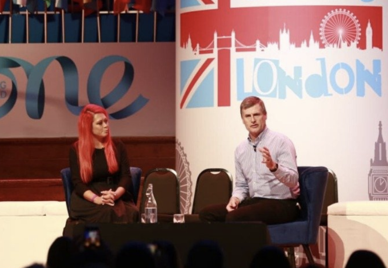Lianna Brinded (L), head of Yahoo Finance UK and Ronan Dunne, CEO of consumer business at Verizon on stage at the One Young World conference in London. Photo: One Young World