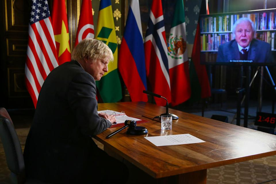 Boris Johnson listens to David Attenborough as he hosts the UN Security Council's virtual meeting on climate change risks in London on Tuesday (local time). Source: Getty