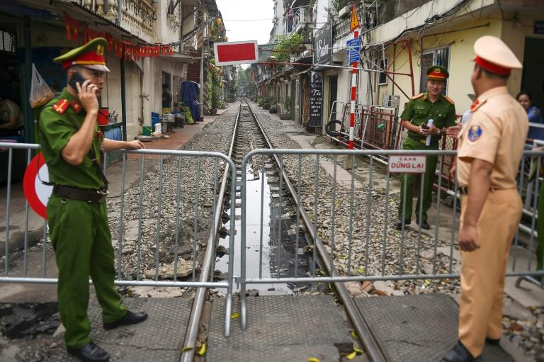 The narrow railway corridor in central Hanoi had become a hotspot among visitors seeking the perfect holiday snap on the atracks - often dodging trains that rumble through daily (AFP Photo/Nhac NGUYEN)