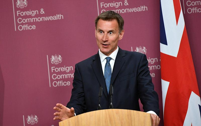 Jeremy Hunt, Foreign Secretary, speaking at a press conference in London - REUTERS