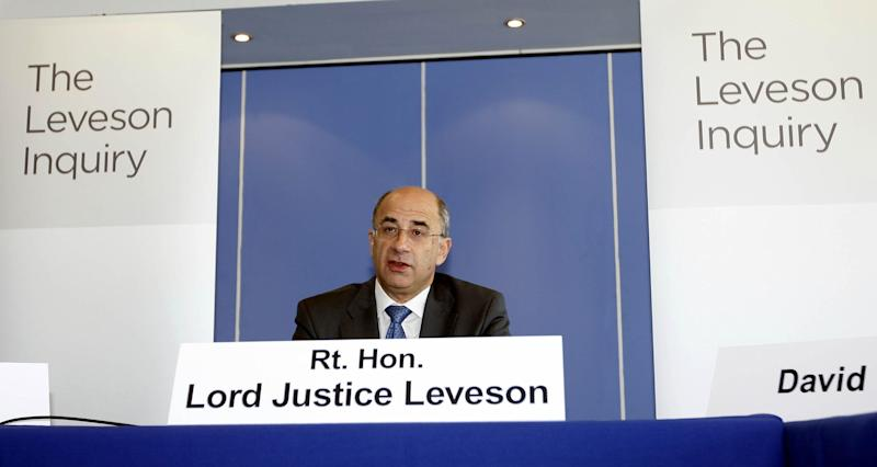 FILE - In this July 28, 2011 file photo, Lord Justice Brian Leveson speaks during the first formal session of his phone hacking inquiry in London. Leveson, who spent a year investigating the misdeeds of Britain's lively newspapers, is giving Britain's Prime Minister David Cameron an early look at his recommendations on Wednesday, Nov. 28, 2012 for the regulation of the press. (AP Photo/Sean Dempsey, Pool-File)