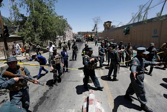 <p>Afghan policemen inspect at the site of a blast in Kabul, Afghanistan, May 31, 2017. (Mohammad Ismail/Reuters) </p>