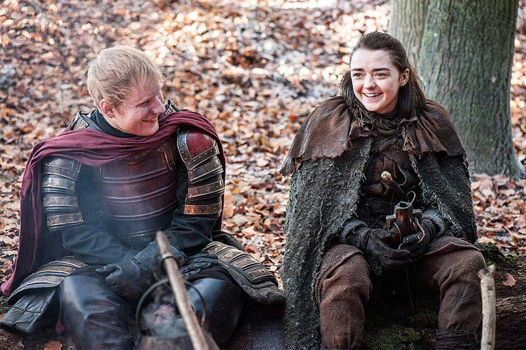 Ed Sheeran as a Lannister soldier and Maisie Williams as Arya Stark in HBO's Game of Thrones. (Photo Credit: Helen Sloan/HBO)
