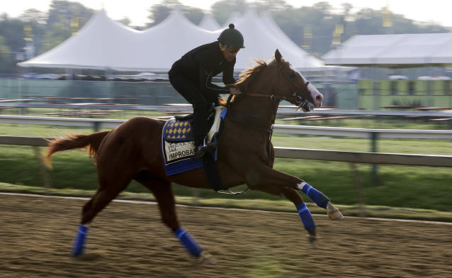 Improbable runs during training for Saturday's Preakness horse race at Pimlico race track in Baltimore, Friday, May 17, 2019. (AP Photo/Steve Helber)