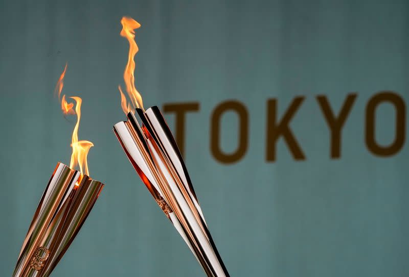 Torches are pictured during a lighting ceremony in Tokyo
