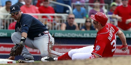 Washington Nationals' Bryce Harper is tagged out at third by Atlanta Braves third baseman Martin Prado while trying to stretch a double into a triple during the fifth inning of a baseball game on Sunday, June 3, 2012, in Washington. The Braves won 3-2. (AP Photo/Alex Brandon)