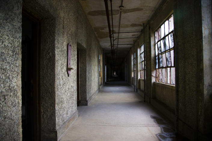 <p>A look down the main corridor of the wards on Ellis Island. Some staff members claim to have seen a ghostly figure of a woman dressed in clothing from the 1920s. (Photo: Gordon Donovan/Yahoo News) </p>