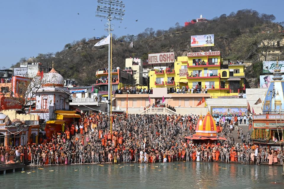 Naga Sadhus (Hindu holy men) gather before taking holy dip in the waters of the River Ganges on the Shahi snan (grand bath) on the occasion of Maha Shivratri festival during the ongoing religious Kumbh Mela festival in Haridwar on March 11, 2021. (Photo by Prakash SINGH / AFP) (Photo by PRAKASH SINGH/AFP via Getty Images)