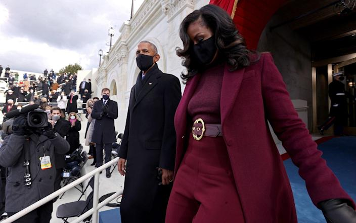 Barack and Michelle Obama arrive for the ceremony in Washington - GETTY IMAGES