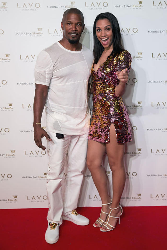 <p>Katie Holmes's man escorted his beauty of a daughter to the LAVO Singapore Grand Opening at Marina Bay Sands on New Year's Eve. (Photo: Ore Huiying/Getty Images for TAO Group) </p>