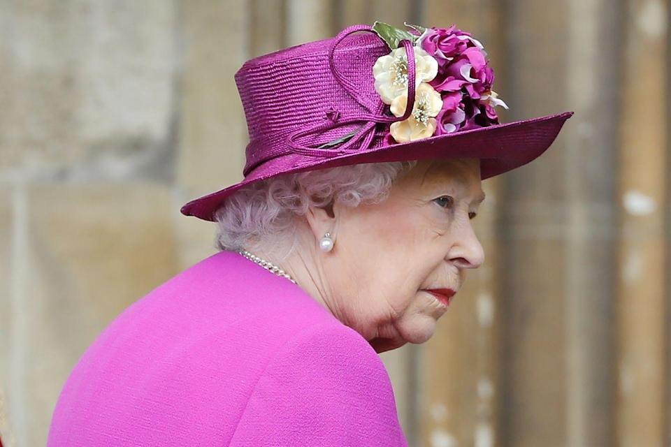 <p>She wore a bright pink ensemble for the occasion.</p>