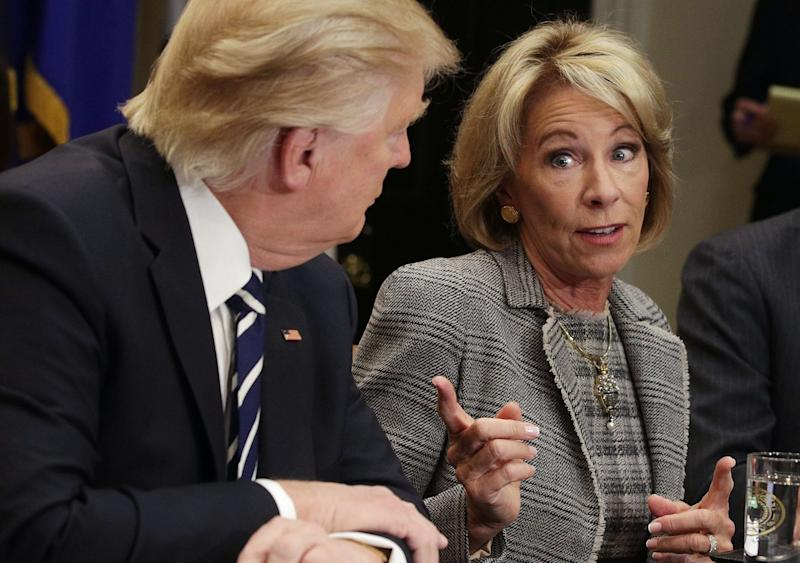 Secretary of Education Betsy DeVos (R) speaks as President Donald Trump (L) listens at the White House February 14, 2017 in Washington, DC. (Photo: Alex Wong/Getty Images)