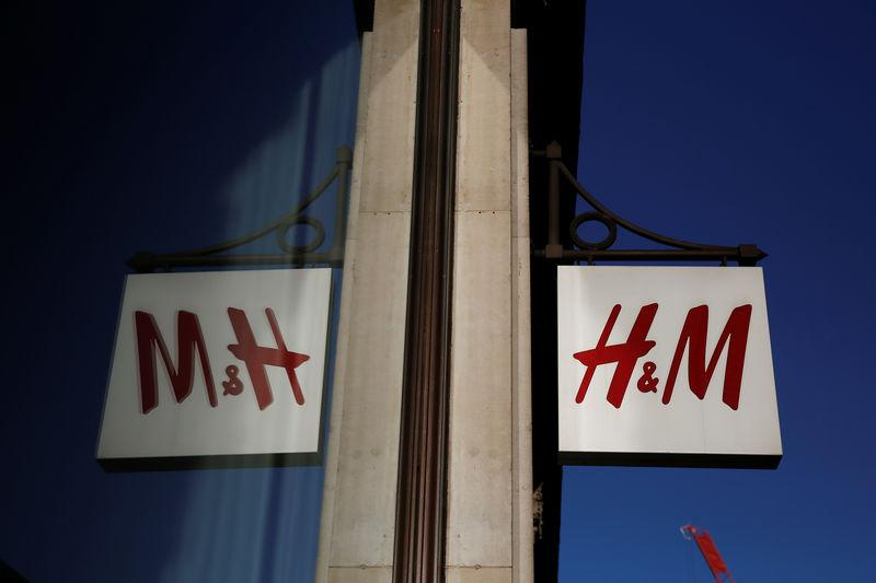FILE PHOTO: A logo is reflected in the window as it hangs outside the H&M store on Oxford Street in London