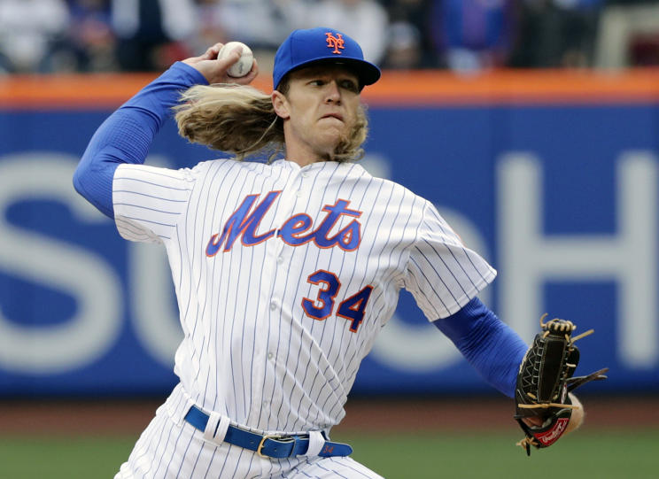 Mets' star Noah Syndergaard struck 10 Cardinals on opening day, meaning one fan had to dye his hair blond. (AP)