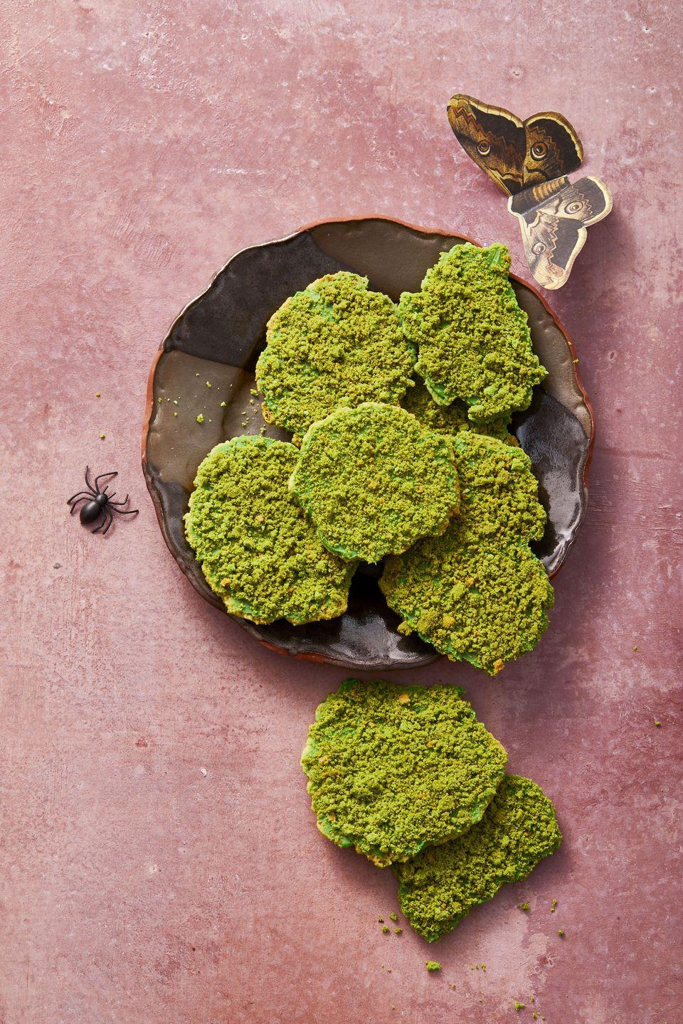 """<p>Top sugar cookies with green frosting and crumbled graham crackers for a unique Halloween treat.</p><p><em><a href=""""https://www.goodhousekeeping.com/food-recipes/a34330679/moss-cookies-recipe/"""" rel=""""nofollow noopener"""" target=""""_blank"""" data-ylk=""""slk:Get the recipe for Moss Cookies »"""" class=""""link rapid-noclick-resp"""">Get the recipe for Moss Cookies »</a></em> </p>"""