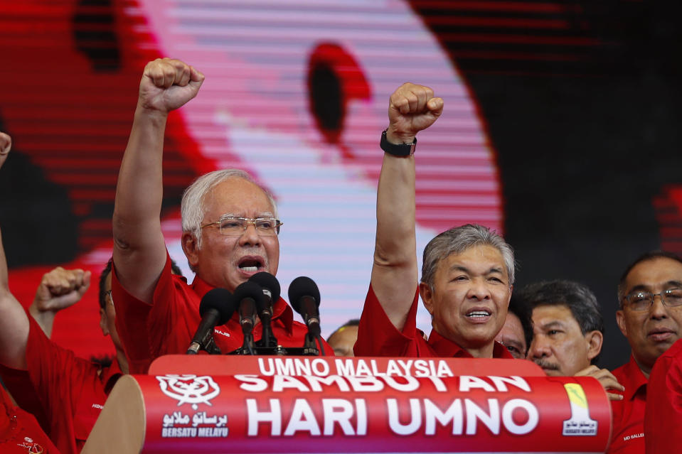 FILE - In this May 11, 2017, file photo, then Malaysian Prime Minister and President of Malaysia's ruling party United Malays National Organization's (UMNO) Najib Razak, left, and Deputy Prime Minister Ahmad Zahid Hamidi chant slogans during a celebration of party's 71st anniversary in Kuala Lumpur, Malaysia. After years of insisting on his innocence, Najib learns his fate this week in his first corruption trial linked to one of the world's biggest financial scandals - a verdict widely seen as a test for the rule of law five months after a new government took power. July 28, 2020's ruling is being closely watched amid a stunning reversal of fortune for Najib's Malay party, which returned to office as a key player in the new ruling alliance. (AP Photo/Vincent Thian, File)