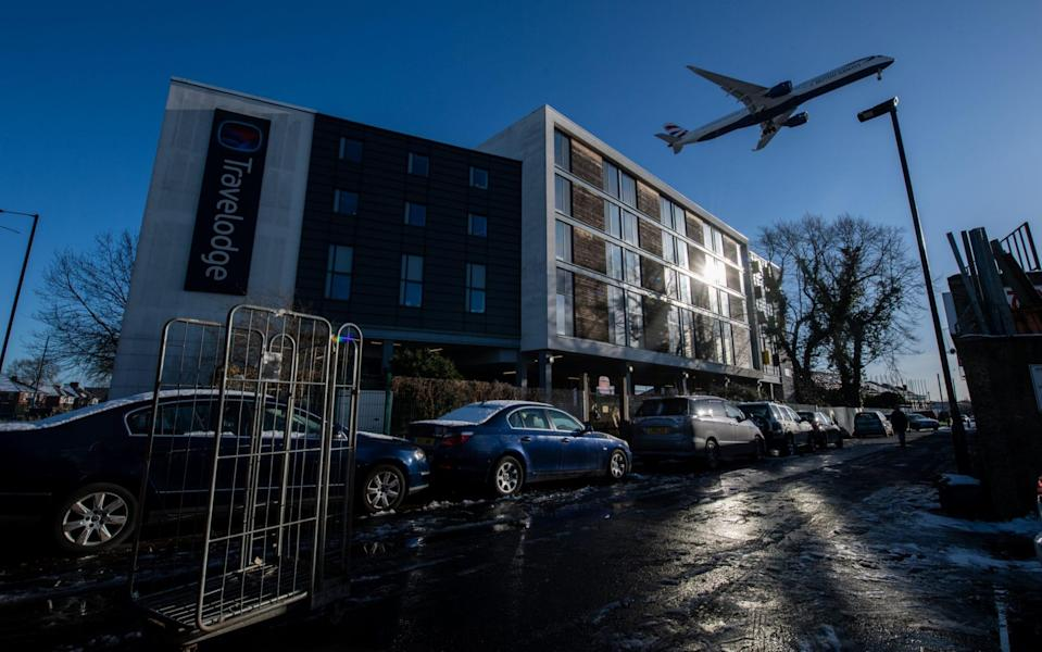 A plane flies over a hotel as it comes in to land at Heathrow Airport - Chris J Ratcliffe/Getty Images Europe