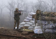 A Ukrainian soldier takes position on the front line at the town of Novoluhanske in the Donetsk region, Ukraine, Monday, Dec. 9, 2019. A long-awaited summit in Paris on Monday aims to find a way to end the war in eastern Ukraine, a conflict that after five years and 14,000 lives lost has emboldened the Kremlin and reshaped European geopolitics. (AP Photo/Vitali Komar)