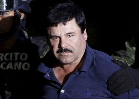 """Recaptured drug lord Joaquin """"El Chapo"""" Guzman is escorted by soldiers at the hangar belonging to the office of the Attorney General in Mexico City, Mexico January 8, 2016. REUTERS/Henry Romero"""