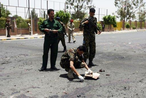 Forensic policemen collect evidence at the site of a suicide bomb attack in Sanaa on Monday. The suicide attack was the deadliest in the country's capital since newly-elected President Abdrabuh Mansur Hadi pledged to oust Al-Qaeda militants from Yemen's mostly lawless and restive southern and eastern provinces
