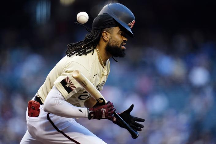Arizona Diamondbacks' Henry Ramos runs into his own bunt attempt for an out during the third inning of a baseball game against the Los Angeles Dodgers Saturday, Sept. 25, 2021, in Phoenix. (AP Photo/Ross D. Franklin)