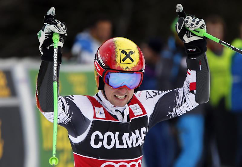Austria's Marcel Hirscher celebrates at the finish area after winning an alpine ski, men's World Cup giant slalom, in Alta Badia, Italy, Sunday, Dec. 22,2013.(AP Photo/Armando Trovati)
