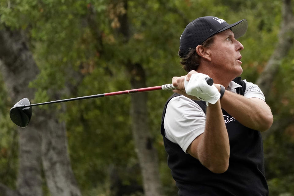 Phil Mickelson hits from the 11th tee during the second round of the Zozo Championship golf tournament Friday, Oct. 23, 2020, in Thousand Oaks, Calif. (AP Photo/Marcio Jose Sanchez)