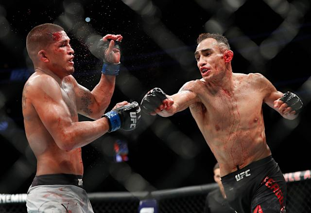 Tony Ferguson (R) punches Anthony Pettis during UFC 229 in Las Vegas on Oct. 6, 2018. Ferguson won by technical knockout during the second round. (AP Photo/John Locher)