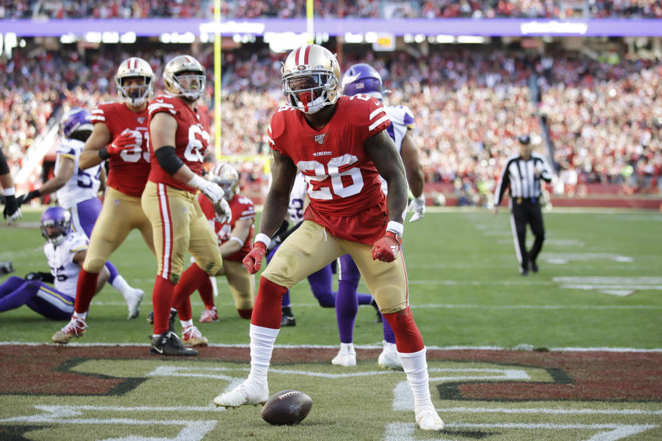 San Francisco 49ers running back Tevin Coleman (26) celebrates after scoring a touchdown against the Minnesota Vikings during the first half of an NFL divisional playoff football game, Saturday, Jan. 11, 2020, in Santa Clara, Calif. (AP Photo/Ben Margot)