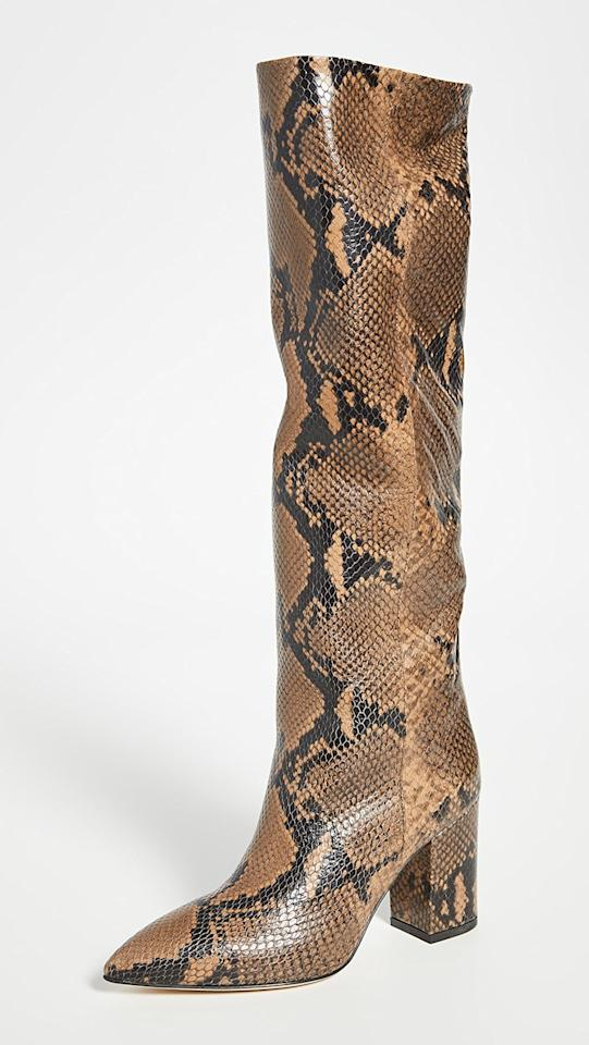 """<p>Take a walk on the wild side in these fun <a href=""""https://www.popsugar.com/buy/Paris-Texas-Python-Print-Boots-554376?p_name=Paris%20Texas%20Python%20Print%20Boots&retailer=shopbop.com&pid=554376&price=795&evar1=fab%3Aus&evar9=45335329&evar98=https%3A%2F%2Fwww.popsugar.com%2Ffashion%2Fphoto-gallery%2F45335329%2Fimage%2F47283852%2FParis-Texas-Python-Print-Boots&list1=shopping%2Cfall%20fashion%2Cboots%2Cfall%20trends%2Ctrends%2Cfall%2Cspring%2Cspring%20fashion&prop13=mobile&pdata=1"""" rel=""""nofollow"""" data-shoppable-link=""""1"""" target=""""_blank"""" class=""""ga-track"""" data-ga-category=""""Related"""" data-ga-label=""""https://www.shopbop.com/python-print-boots-heel-paris/vp/v=1/1517388216.htm?folderID=13464&amp;fm=other-shopbysize-viewall&amp;os=false&amp;colorId=12408&amp;ref=SB_PLP_EP_5"""" data-ga-action=""""In-Line Links"""">Paris Texas Python Print Boots</a> ($795).</p>"""