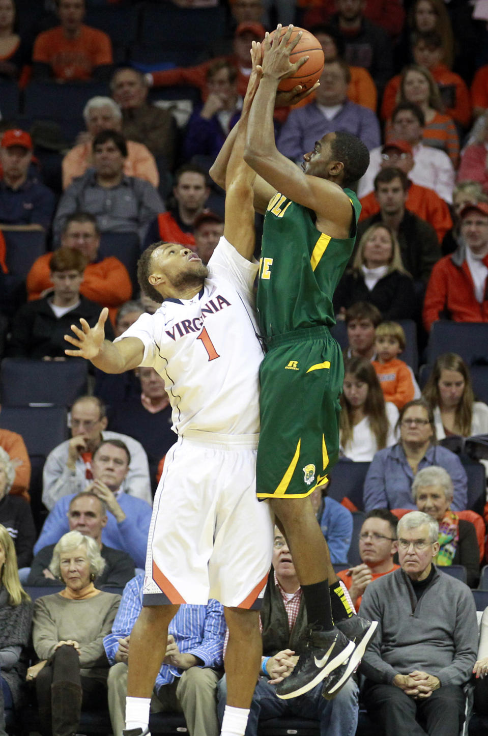 Norfolk State guard D'Shon Taylor (4) shoots over Virginia guard Justin Anderson (1) during an NCAA college basketball game, Sunday Nov. 16, 2014 in Charlottesville, Va. (AP Photo/Andrew Shurtleff)